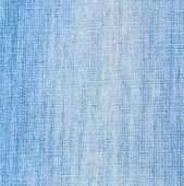 picture of denim jeans  - Jeans denim light blue cloth fragment as a background texture composition - JPG