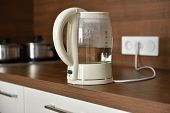 picture of kettles  - Electric glass kettle on a domestic kitchen - JPG