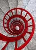 stock photo of balustrade  - Spiral stone stairs with red painted balustrade view from top - JPG