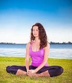 image of yoga  - Beautiful young woman has a meditation on yoga class - JPG