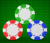Roulette Chips Over Green Textured White