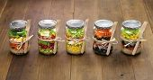 stock photo of pecan nut  - homemade healthy salad in glass jar - JPG
