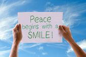 stock photo of feeling better  - Peace Begins with a Smile card with sky background - JPG