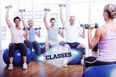 picture of senior class  - The word classes and fitness class with dumbbells sitting on exercise balls against badge - JPG