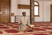 picture of islamic religious holy book  - Black African Muslim Man Reading Holy Islamic Book Koran - JPG