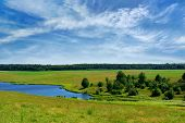 stock photo of hayfield  - Clear Lake in the field against the blue sky - JPG