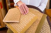 stock photo of interior decorator  - Interior Designer buying floor mats in home improvement store - JPG