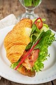 picture of continental food  - Fresh croissant for breakfast stuffed with bacon - JPG