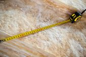 picture of glass-wool  - Measure tape on mineral wool close up - JPG
