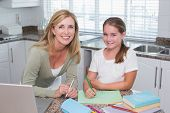 pic of homework  - Happy mother helping daughter doing homework - JPG