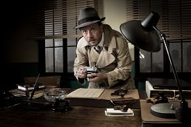 image of 1950s style  - Retro spy agent caught photographing important documents on office desk 1950s style - JPG