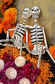 foto of altar  - Traditional mexican Day of the dead altar with skeletons and candles - JPG
