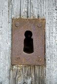 stock photo of keyhole  - View of the old keyhole on a wooden door  - JPG