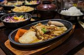 image of dory  - Grilled pangasius dory with mushroom sauce in japanese restaurant. ** Note: Shallow depth of field - JPG