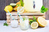 image of mason  - Homemade lemonade in beverage dispencer and mason jars - JPG