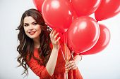 stock photo of peep  - Cheerful girl is holding colored balloons in her arms - JPG