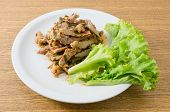 picture of thai cuisine  - Thai Cuisine and Food Thai Traditional Nam Tok or Spicy Grilled and Sliced Beed Salad Served with Lettuce Leaves - JPG