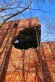 stock photo of artillery  - The building after being hit by an artillery shell - JPG