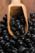 picture of soybeans  - A lot of black soybeans on wooden background - JPG