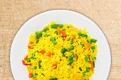stock photo of boil  - Fragment of white dish with boiled rice cooked with turmeric with boiled vegetables  - JPG