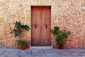 picture of wooden door  - Wooden door of an old stone house Spain - JPG