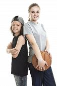 foto of ball cap  - A Portrait of brother and sister with a basket ball - JPG