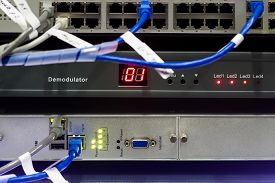 pic of telecommunications equipment  - Telecommunications Equipment in a metal rack - JPG
