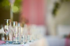 image of banquet  - Three empty glasses on banquet table in restaurant - JPG