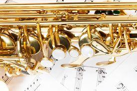 foto of musical scale  - Shiny golden alto saxophone keys close - JPG