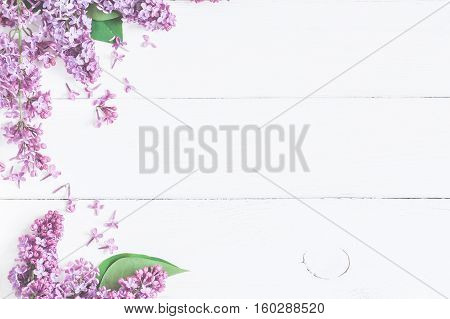 poster of Spring flowers. Lilac flowers on white wooden background. Top view flat lay