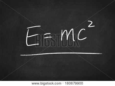 poster of Einstein formula E=mc2 on blackboard chalkboard background