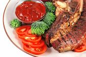 served beef steak and chili spicy sauces