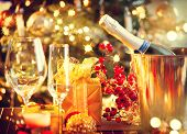 Christmas And New Year Holiday Table Setting with Champagne. Celebration. Place setting for Christma poster
