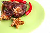 roast beef chunks on green dish over white