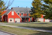 stock photo of duplex  - A red duplex on the corner of a street - JPG