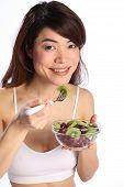 Girl eating healthy fruit salad