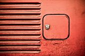 stock photo of campervan  - grunged panel and fuel filler cap on a vintage RV auto - JPG