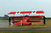 foto of ultralight  - old restaurated light aircraft before lift off with peoples help - JPG