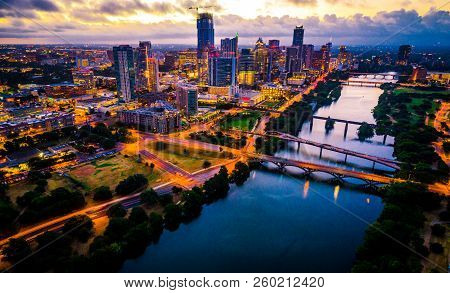 poster of Aerial Drone View Of Austin , Texas Downtown Skyline Cityscape With City Lights On At Dawn Right As