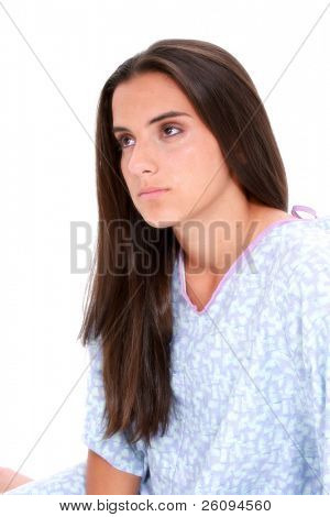 Picture or Photo of Beautiful dark haired teen girl in hospital gown crying. Eyes red with tears falling down cheeks.