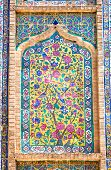 Tiled background, oriental ornaments from Vakili Mosque, Shiraz, Iran