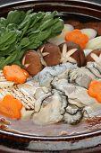 Kaki Dotenabe, Austern in einem Topf auf den Tisch, japanisches Essen gekocht