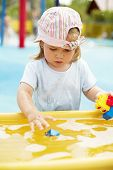 picture of girl toy  - Small girl playing in some holiday park - JPG