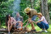 Company Friends Or Family Making Bonfire In Forest Nature Background. Friends Hang Out Near Bonfire  poster