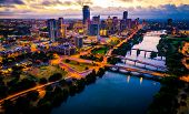 Aerial Drone View Of Austin , Texas Downtown Skyline Cityscape With City Lights On At Dawn Right As  poster