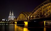 Koln - APRIL 2 : Night shot of Cologne dom and Hohenzollern bridge April 2, 2009 in Cologne, Germany
