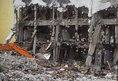 Destroyed Building Industrial. Building Demolition By Explosion. Abandoned Concrete Building With Ru poster