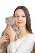 Young woman with scottish-fold cat isolated on white background