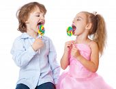 Boy and girl with lollipops. Isolated on white background