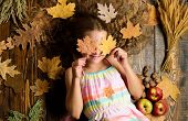 Child With Long Hair With Fallen Maple Leaves. Fall Nature Gifts. Autumn Coziness Is Just Around. Ti poster